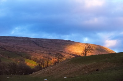 Sunset reflected off a hillside in the dales