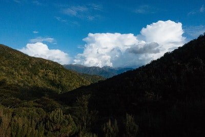 A view from Perry Saddle Hut showing clouds billowing on the horizon