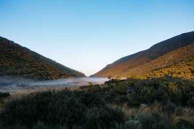 Mist runs across the pass at Perry Saddle Hut