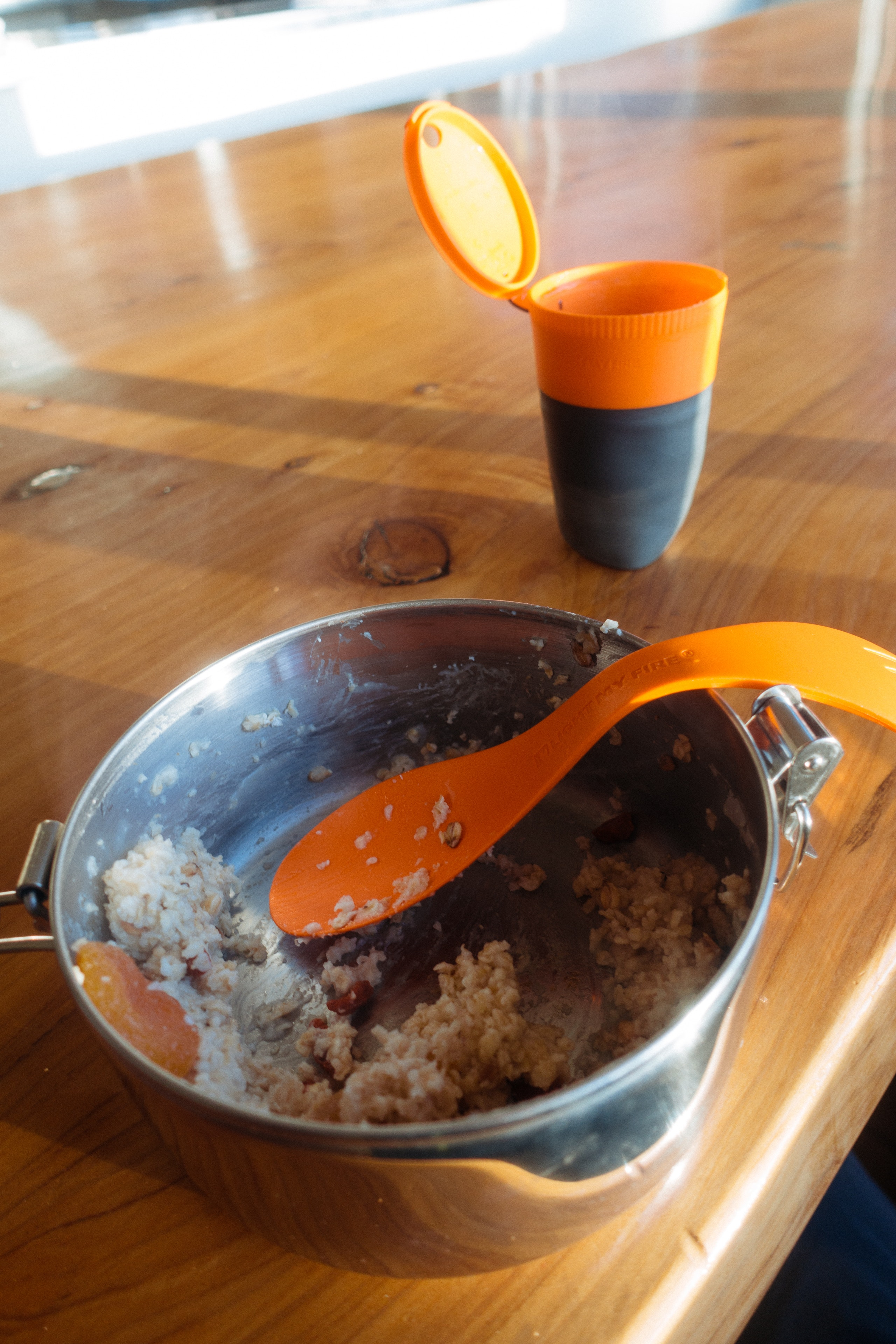 A breakfast of porridge with a spork from a camping pan