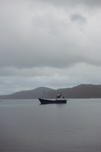 A boat anchored at Port William