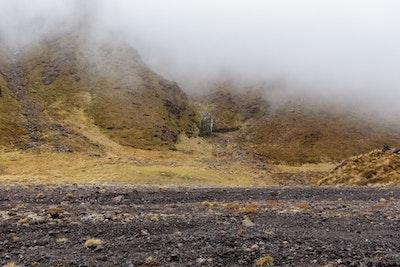 Mist descends over the mountainside
