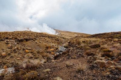 Steam rises from the hillside