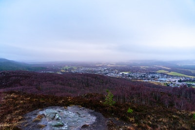 A view back down over Aviemore in the rain